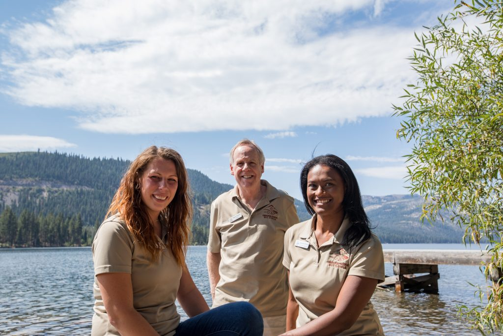 three team members with truckee river backdrop